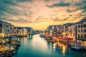 Famous grand canal from Rialto Bridge at blue hour, Venice, Italy.