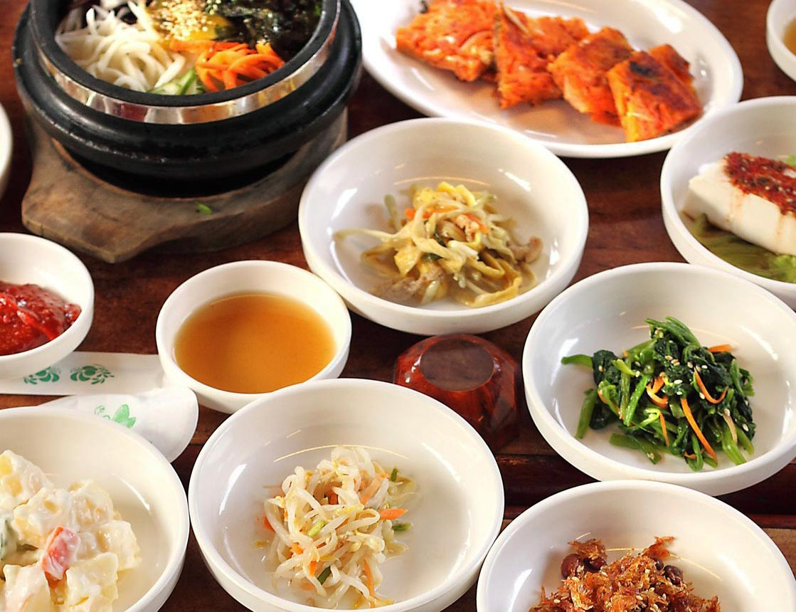 Numerous Dishes filled with a variety of South Korean cuisine