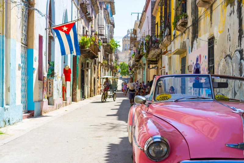 Cuban streets with an red old Chevy