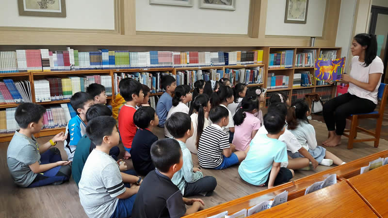 Reading to my students while teaching ESL in South Korea