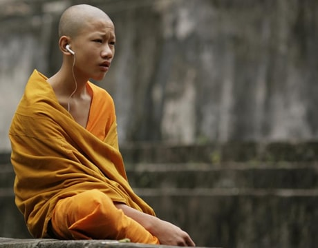 Lao Monk with headphones