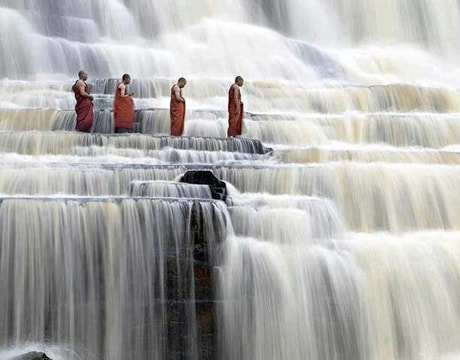 Monks in a waterfall